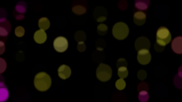 abstract-background-with-animated-glowing-purple-magenta-green-yellow-bokeh-with-alpha-channel-loop