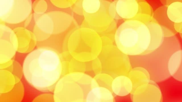 Resumen-de-fondo-con-rojo-y-oro-brillante-animación-loop-bokeh-alfa