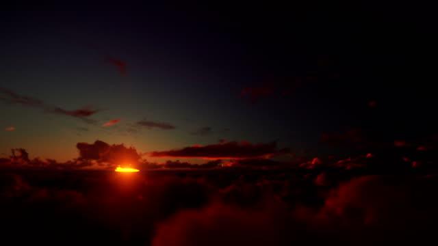 Flight-above-clouds-against-beautiful-timelapse-sunrise-4K