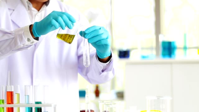 Closeup-man-laboratory-scientist-working-at-lab-with-test-tubes