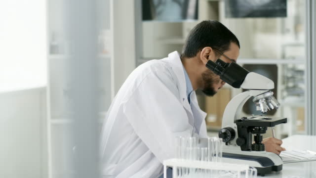 Black-Male-Scientist-Doing-Research