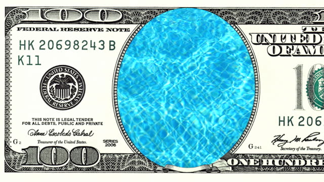 Blue-water-in-swimming-pool-in-frame-of-100-dollar