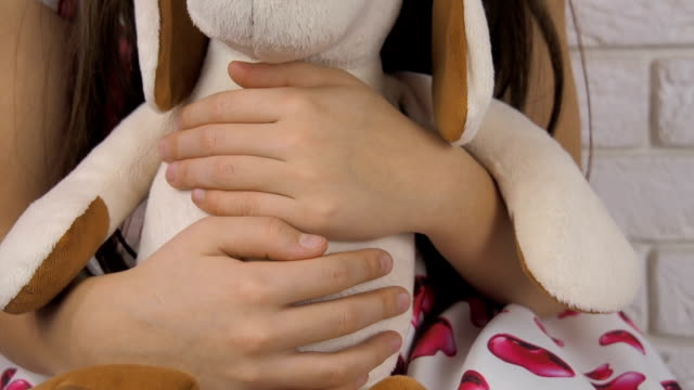 A-child-is-hugging-a-toy-