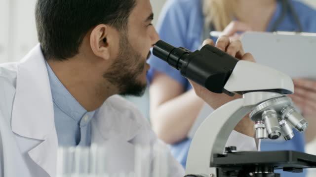 Black-Male-Scientist-Using-Microscope