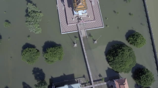 Aerial-overhead-view-of-a-pagoda-is-surrounded-by-floodwaters