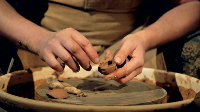 A-potter-manually-shapes-a-clay-spoon-
