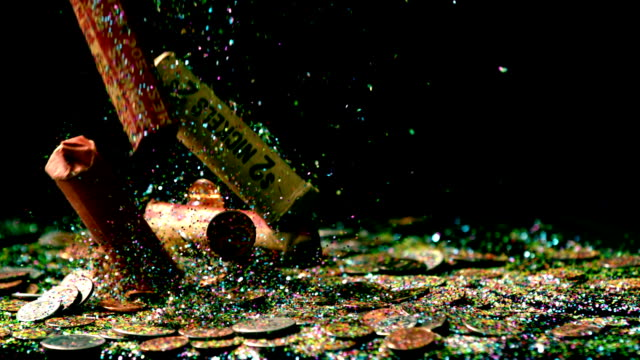 slow-motion-falling-coin-rolls-and-confetti