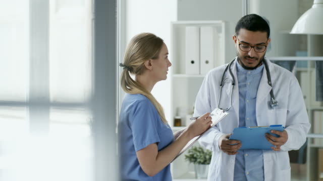 Young-Doctors-Discussing-Work-in-Clinic