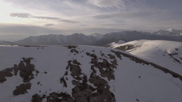 Aerial-flight-over-a-snow-mountains-park