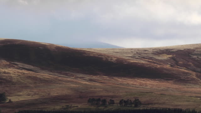 Scottish-mountain-scene-of-glen-during-stormy-weather-in-the-cairngorms-NP-during-October-autumn-