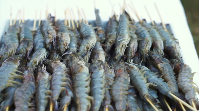 Raw-prawns-on-skewers-prepare-for-BBQ