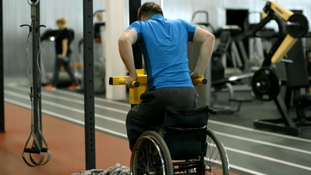 Man-with-Physical-Disability-Doing-Dips