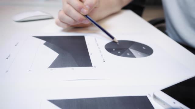 Young-man-examining-diagrams