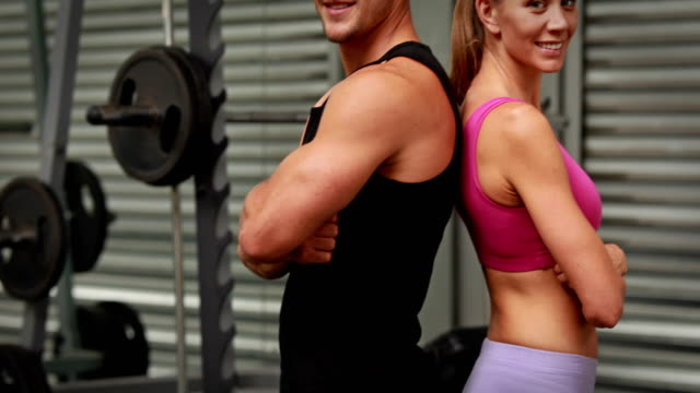 Couple-posing-at-gym-gym