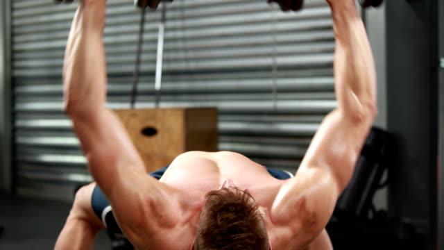 Fit-shirtless-man-lifting-dumbbells