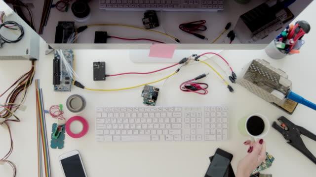 Female-electronics-engineer-typing-on-computer-keyboard