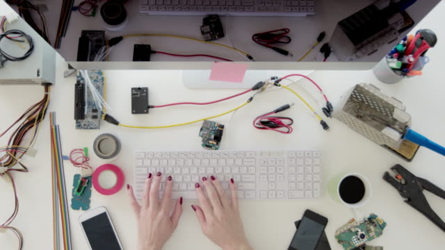 Female-electronics-engineer-working-on-a-computer
