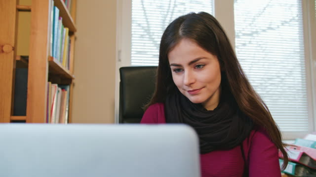 Woman-Working-at-Home-on-Laptop-Computer
