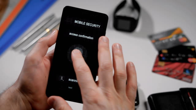 Secure-and-quick-access-to-your-account-with-fingerprint-scanning-The-application-on-the-smartphone-the-man-applies-his-finger-to-the-scanner-the-program-allows-access