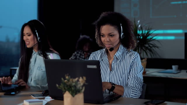 People-working-in-call-center-at-night