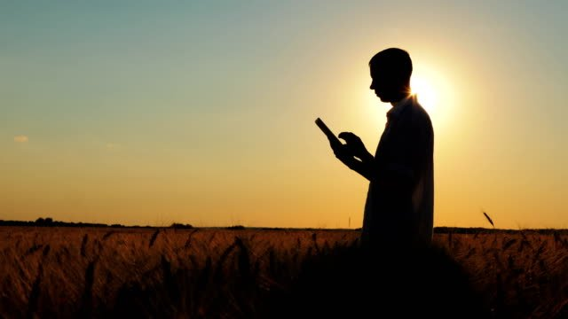 Silhouette-of-Agrarians-With-a-Tablet-In-Hands