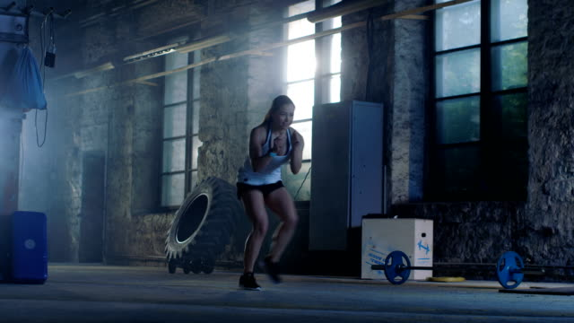 Fit-Athletic-Woman-Does-Footwork-Running-Drill-in-a-Deserted-Factory-Remodeled-into-Gym-Cross-Fitness-Exercise/-Workout-Aimed-at-Strengthening-Legs-Enhancing-Her-Agility-and-Speed-