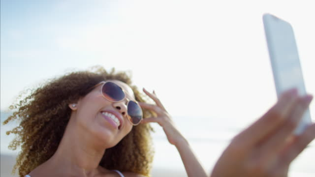 Voluptuous-African-American-female-on-beach-in-sunshine