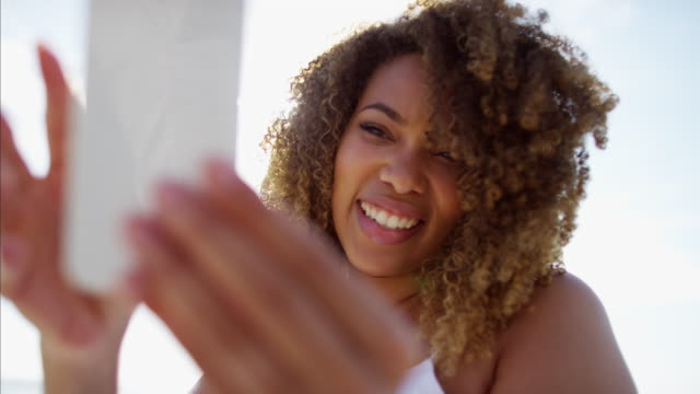 African-American-female-waving-farewell-using-video-messaging