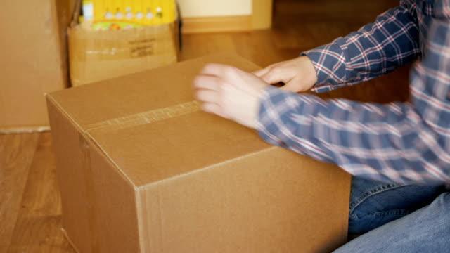 A-man-pastes-a-QR-code-on-a-box-Delivery-service-Online-shop-Bar-code-