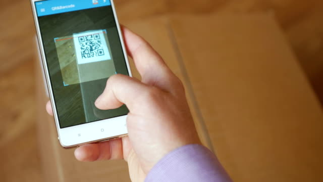 Scanning-QR-code-with-smart-phone-The-man-reads-the-bar-code-using-the-application-on-the-smartphone-