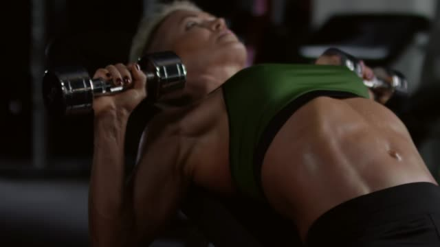 Strong-Woman-Doing-Dumbbell-Bench-Press-Exercise