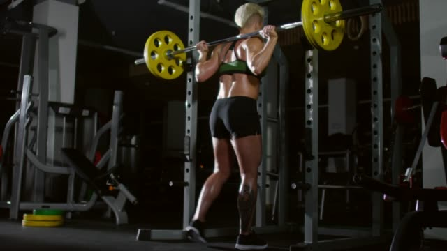 Strong-Athletic-Woman-Squats-with-Barbell