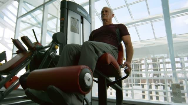 Elderly-Man-on-Leg-Curl-Machine