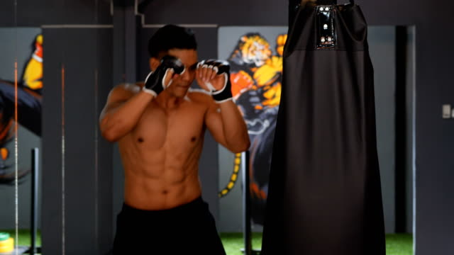 Asian-men-s-exercise-with-boxing-in-a-gym-Living-healthy-lifestyle-concept-