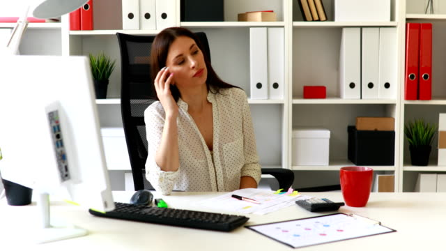 businesswoman-in-white-blouse-putting-documents-on-table