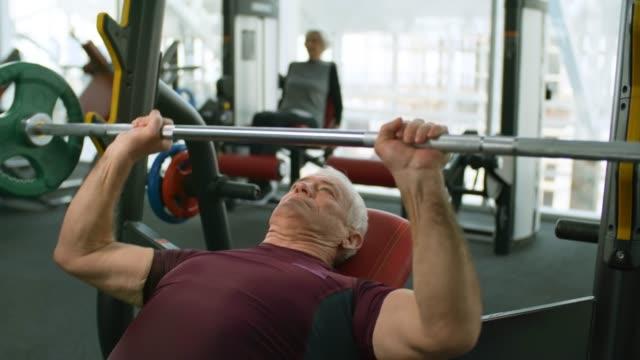 Senior-Man-Doing-Bench-Press-Exercise