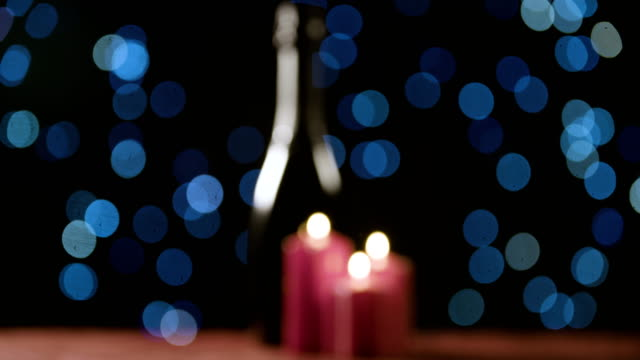 Christmas-candles-and-bottle-of-champagne