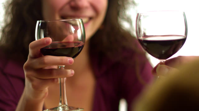 A-woman-sitting-with-a-man-drinks-wine-in-slow-motion