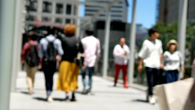 Anonymous-crowd-of-people-walking-on-walk-way