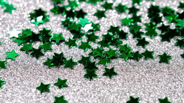 Sparkling-glitter-in-the-shape-of-a-star-Close-up-on-a-silver-background
