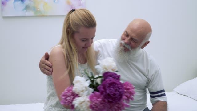 Granddaughter-visit-grandfather-in-hospital