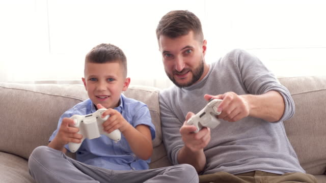 Father-with-son-rejoice-at-victory-in-video-game