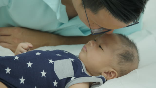 Close-up-shot-of-asian-father-caressing-baby