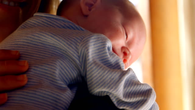 Mother-consoling-her-baby-boy-in-living-room-4k