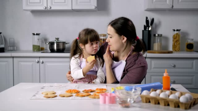 Mom-teaching-body-language-girl-with-down-syndrome