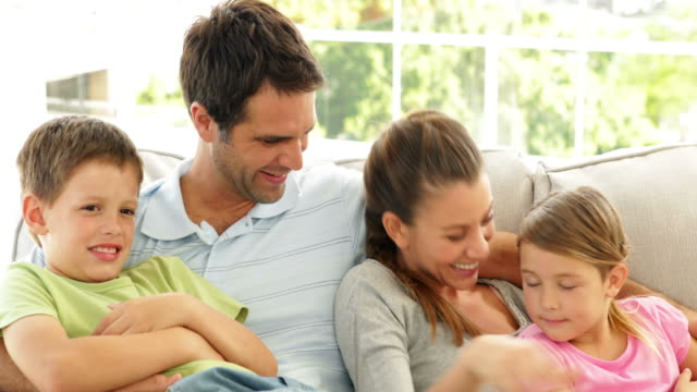 Cute-family-relaxing-together-on-the-couch