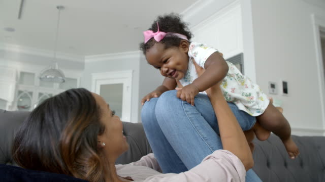 Slow-Motion-Shot-Of-Mother-Playing-With-Daughter-At-Home