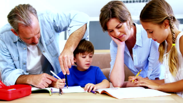 Father-and-mother-helping-children-with-homework