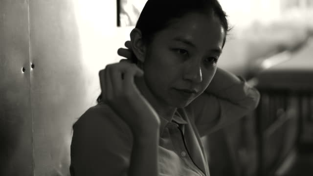 Asian-woman-sitting-alone-in-hospital-Worried-and-anxious-from-thinking-of-bad-news-4K