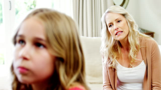 Mother-arguing-with-her-daughter-in-living-room